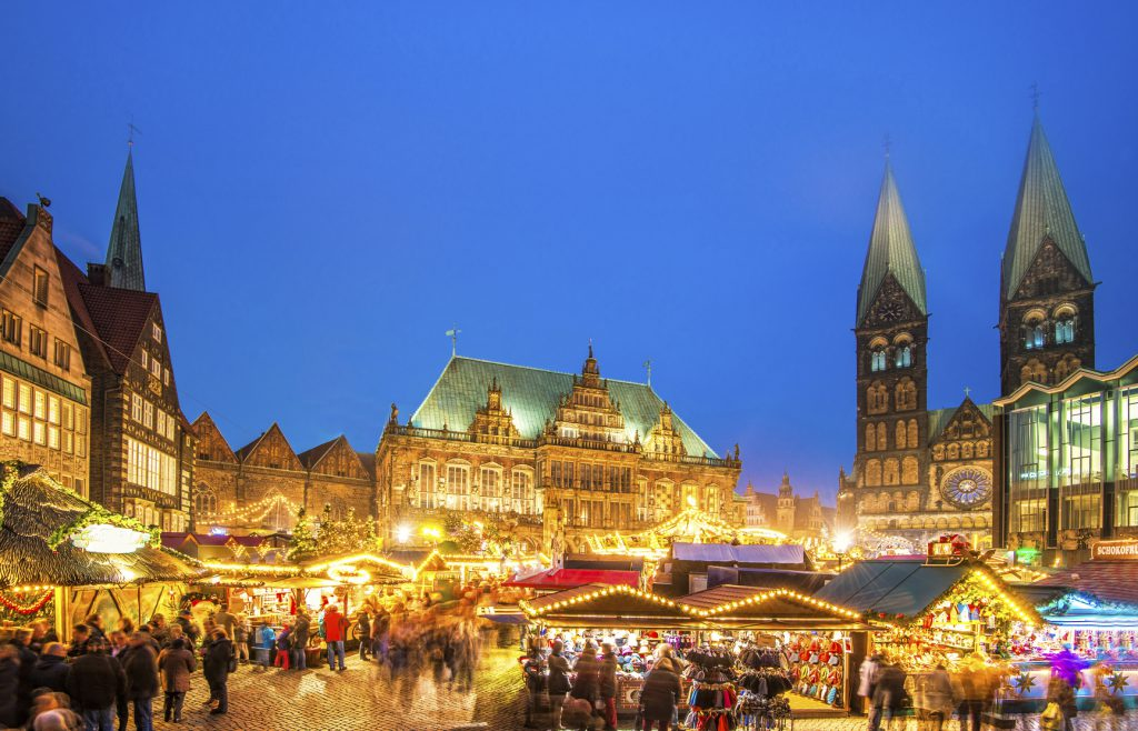 Bremen´s beautiful Christmas market at the city´s town square with the illuminated town hall, St. Peter's Cathedral, and parliament.