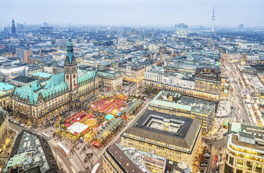 Aerial view on the winterly illuminated city of Hamburg. Christmas decoration, illuminated buildings and streets, the christmas market at the town hall.