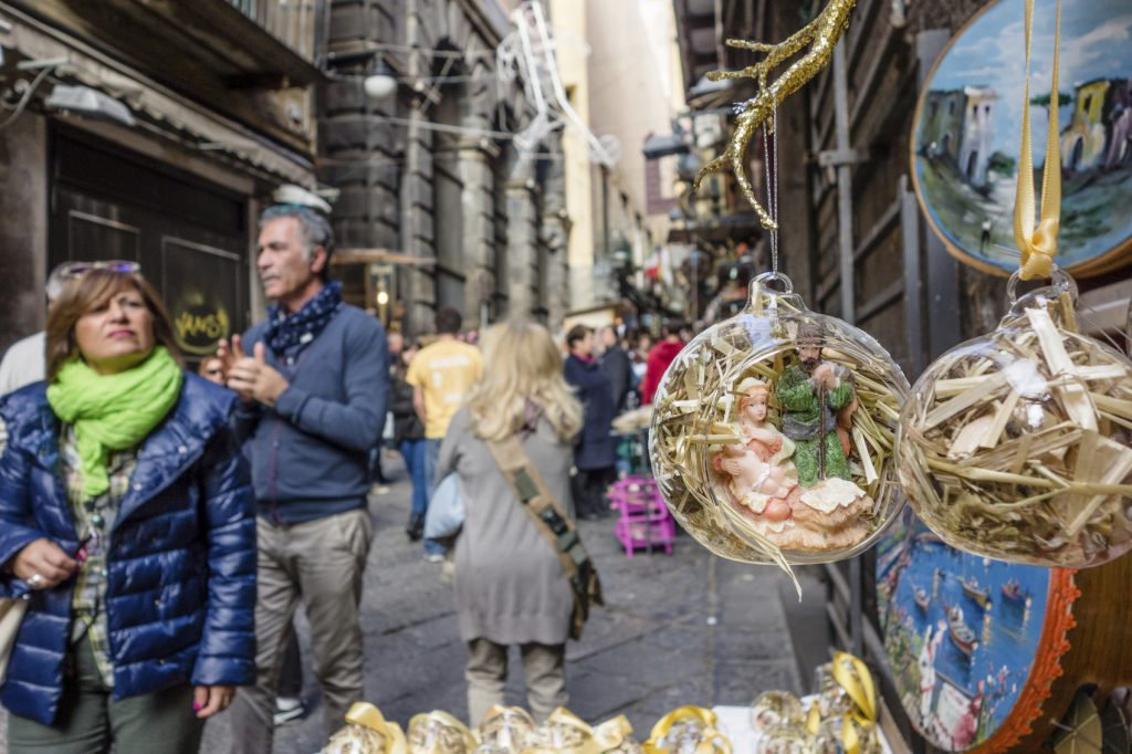 Naples, Italy - November 9, 2014: Christmas Market in Naples, Italy. Some people walking in the street observing the Christmas decorations for sale.